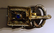 Buckle, silver gilt and glass.  Ostrogothic, 500-600, Tuscany, Italy.