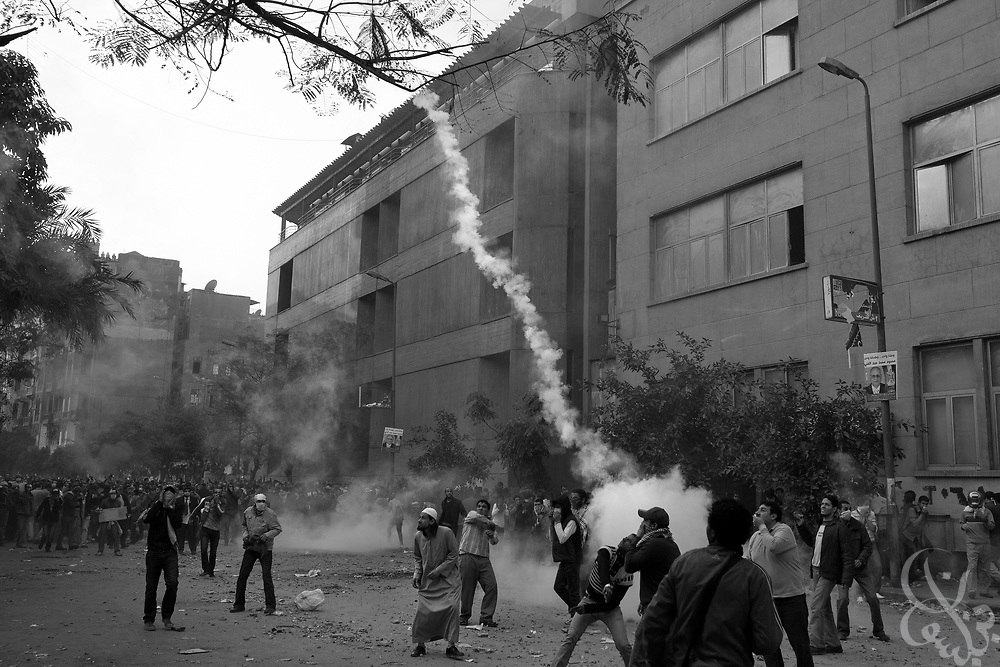 Egyptian protestors hurl a tear gas canister back towards the police who shot it during ongoing demonstrations November 20, 2011 near Tahrir square in central Cairo, Egypt.  Protestors demanding the transition of power from military to civilian control clashed with Egyptian security forces for a second straight day in central Cairo, with hundreds injured and at least 11 protestors killed.  (Photo by Scott Nelson)