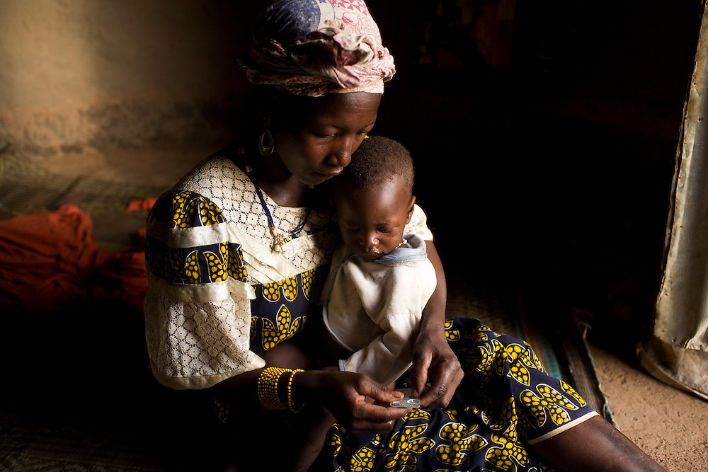 Maimouna Bakayogo gives her sick baby the zinc tablets dissolved in water. interview by Viv. ..Sogola, Mali. .