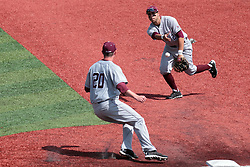 26 April 2014:   first baseman Ryan Casillas flips the ball to covering pitcher Todd Eaton to put out Jack Czeszewski during an NCAA Division 1 Missouri Valley Conference (MVC) Baseball game between the Southern Illinois Salukis and the Illinois State Redbirds in Duffy Bass Field, Normal IL