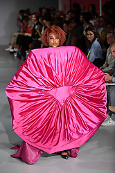 © Licensed to London News Pictures. 13/09/2019. LONDON, UK.  A model presents a look by Ellen Larsson of Swedish School of Textiles during Fashion Scout SS20, an off schedule show at Victoria House in Bloomsbury Square, on the opening day of London Fashion Week.  Photo credit: Stephen Chung/LNP