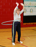 Middletown, New York - The winner of the hula hoop contest shows her form during Family Night at the Middletown YMCA on April 2, 2011.