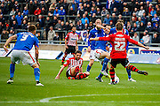 Exeter City Midfielder David Wheeler makes a vital clearance  during the Sky Bet League 2 match between Carlisle United and Exeter City at Brunton Park, Carlisle, England on 17 October 2015. Photo by Craig McAllister.