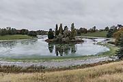 Woodstock, England, UK, October 14 2018 - Pond of River Glyme in the park of Blenheim Palace.