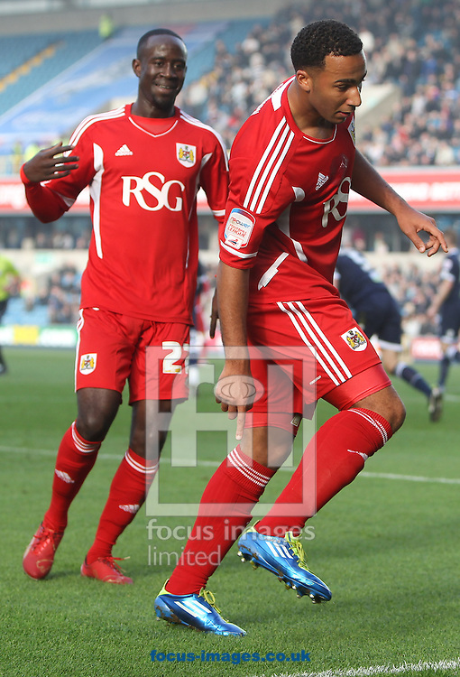 Picture by John Rainford/Focus Images Ltd. 07506 538356.20/11/11.Nicky Maynard and Albert Adomah of Bristol City celebrate the opening goal against Millwall during the Npower Championship match at New Den stadium, London.