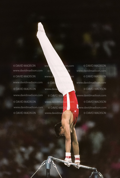 SEATTLE - JULY 1990:  Trent Dimas of the United States performs on the high bar during the men's gymnastics competition of the 1990 Goodwill Games held from July 20 - August 5, 1990.  The gymnastics venue was the Tacoma Dome in Tacoma, Washington.  (Photo by David Madison/Getty Images)
