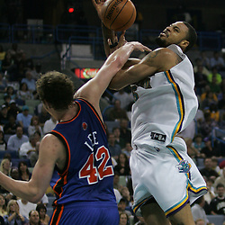 New Orleans Hornets center, Tyson Chandler #6 is fouled by New York Knicks forward David Lee #42 in the third quarter of their NBA game on April 4, 2008 at the New Orleans Arena in New Orleans, Louisiana. New Orleans Hornets defeated the New York Knicks 118-110 and with the win clinched a NBA Playoff birth.