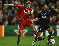 Photo: Paul Thomas.<br /> Liverpool v Bordeaux. UEFA Champions League, Group C. 31/10/2006.<br /> <br /> Steven Gerrard (L) of Liverpool and Florian Marange go for the ball.