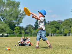 Pictured: 3 year old Elliott Brennan from Leith has fun in the sun playing frisbee on Leith Links as the Capital sweltered in 27 degree heat.<br /> <br /> &copy; Dave Johnston / EEm