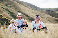 candid family photos of Jess and Adrian in arrowtown hiking in autumn with Lilia, Mitchell and Oswald by felicity jean photography