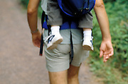 man hiking with baby on his back