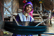 A Karen woman spinning cotton in a village in northern Thailand.