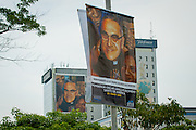 Romero portraits in the San salvador skyline. El Salvador prepares for the beatification ceremony and mass announcing the beatification of Archbishop Oscar Romero. The Archbishop was slain at the alter of his Church of the Divine Providence by a right wing gunman in 1980. Oscar Arnulfo Romero y Galdamez became the fourth Archbishop of San Salvador, succeeding Luis Chavez, and spoke out against poverty, social injustice, assassinations and torture. Romero was assassinated while offering Mass on March 24, 1980.