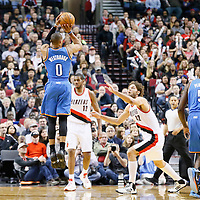 04 December 2013: Oklahoma City Thunder point guard Russell Westbrook (0) takes a jumpshot over Portland Trail Blazers center Robin Lopez (42) during the Portland Trail Blazers 111-104 victory over the Oklahoma City Thunder at the Moda Center, Portland, Oregon, USA.