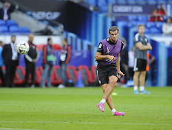 Real Madrid's Gareth Bale hits a free kick in training - Photo mandatory by-line: Joe Meredith/JMP - Mobile: 07966 386802 11/08/2014 - SPORT - FOOTBALL - Cardiff - Cardiff City Stadium - Real Madrid v Sevilla - UEFA Super Cup - Press Conference and Open Training session