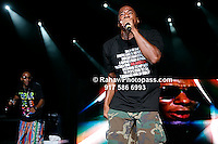 Mos Def (multi colored pants) and Q - Tip (khaki green camouflage pants and knapsack)  performing at Nikon at Jones Beach Amphitheater for 'Rock The Bells' 2008 on August 3, 2008. . Rock The Bells
