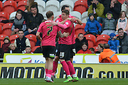 Aaron Williams (41) of Peterborough United celebrates with Harry Beautyman (16) of Peterborough United and Jon Taylor (7) of Peterborough United after he scored a goal to go 1 all during the Sky Bet League 1 match between Doncaster Rovers and Peterborough United at the Keepmoat Stadium, Doncaster, England on 19 March 2016. Photo by Ian Lyall.