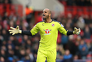 Reading goalkeeper Ali Al Habsi (26) celebrates Reading's early goal during the Sky Bet Championship match between Charlton Athletic and Reading at The Valley, London, England on 27 February 2016.