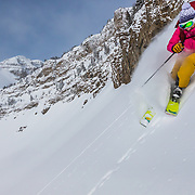Kim Havell skis backcountry powder near Cody Peak and Jackson Hole Mountain Resort near Teton Village, Wyoming.