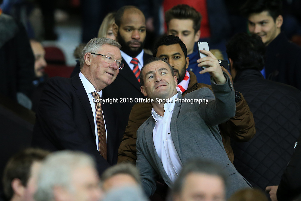 16 December 2015 - Barclays Premier League - Manchester United v Chelsea - Former United eager Sir Alex Ferguson poses for a selfie with a fan - Photo: Marc Atkins / Offside.