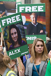 © London News Pictures. 05/10/2013.  London, UK. Georgie Harris, sister of  imprisoned Greenpeace activist Alex Harris holding a placard showing her sisters face.  Supporters of Greenpeace stage a demonstration outside the Russian Embassy in London to protest against the arrest of 30 Greenpeace activists, known as the 'Arctic 30' who charged with piracy by a Russian court, following a peaceful protest against Arctic oil drilling at an oil platform in the Pechora Sea. Photo credit Ben Cawthra/LNP