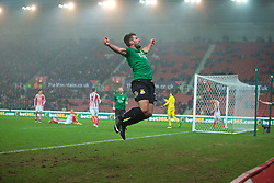 STOKE-ON-TRENT, ENGLAND - Sunday, January 4, 2015: Wrexham's Mark Carrington celebrates scoring the second goal against Stoke City during the FA Cup 3rd Round match at the Britannia Stadium. (Pic by David Rawcliffe/Propaganda)