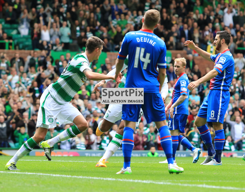 Celtic's Mikael Lustig wheels away to celebrate his  opening goal during the Glasgow Celtic FC v Inverness Caledonian Thistle FC Scottish Premiership 15th August 2015 ©Edward Linton | SportPix.org.uk