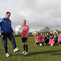 Denis Hynes shows his foot work to Aoife McNamara as Orla Maloney, Elaine Wall, Laura Browne, Jane Taylor,Frank Gormley and Marie Barrett - Mountshannon Celtic look on at the launch of the FAI AVIVA Easter Soccer Sisters during the week.<br /> Photograph by Yvonne Vaughan
