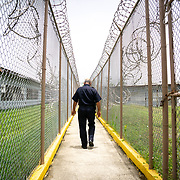 JULY 19, 2018----BAYAMON, PUERTO RICO---<br /> A prison guard walks to one of the buildings in the Bayamon Correctional Complex which is made up of four buildings. The Puerto Rico Corrections and Rehabilitation Department is in the middle of a project to downsize by transferring inmates to private jails in the United States and closing institutions like this.<br /> (Photo by Angel Valentin/Freelance)