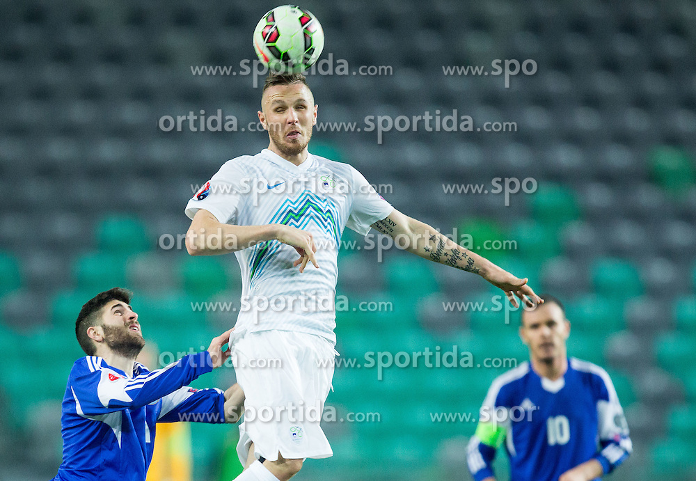 Alessandro Golinucci of San Marino vs Jasmin Kurtic of Slovenia during football match between NationalTeams of Slovenia and San Marino in Round 5 of EURO 2016 Qualifications, on March 27, 2015 in SRC Stozice, Ljubljana, Slovenia. Photo by Vid Ponikvar / Sportida