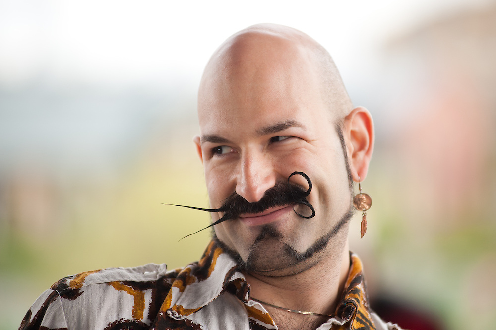 "Keith Haubrich of Seattle, who uses the moniker ""Gandhi Jones"", displays his mustache in Bend, Oregon on Saturday, June 5, 2010 at the Beard Team USA National Beard and Mustache Championships. Haubrich placed third in the mustache category of the competition."