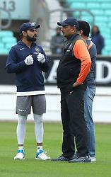 Virat Kohli (left) speaks to Ravi Shastri (right) during the nets session at The Kia Oval, London.
