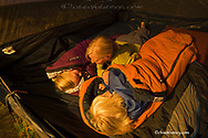 Kirsten Sabin telling children Elise and Chase bed time stories in tent near Whitefish Montana model released