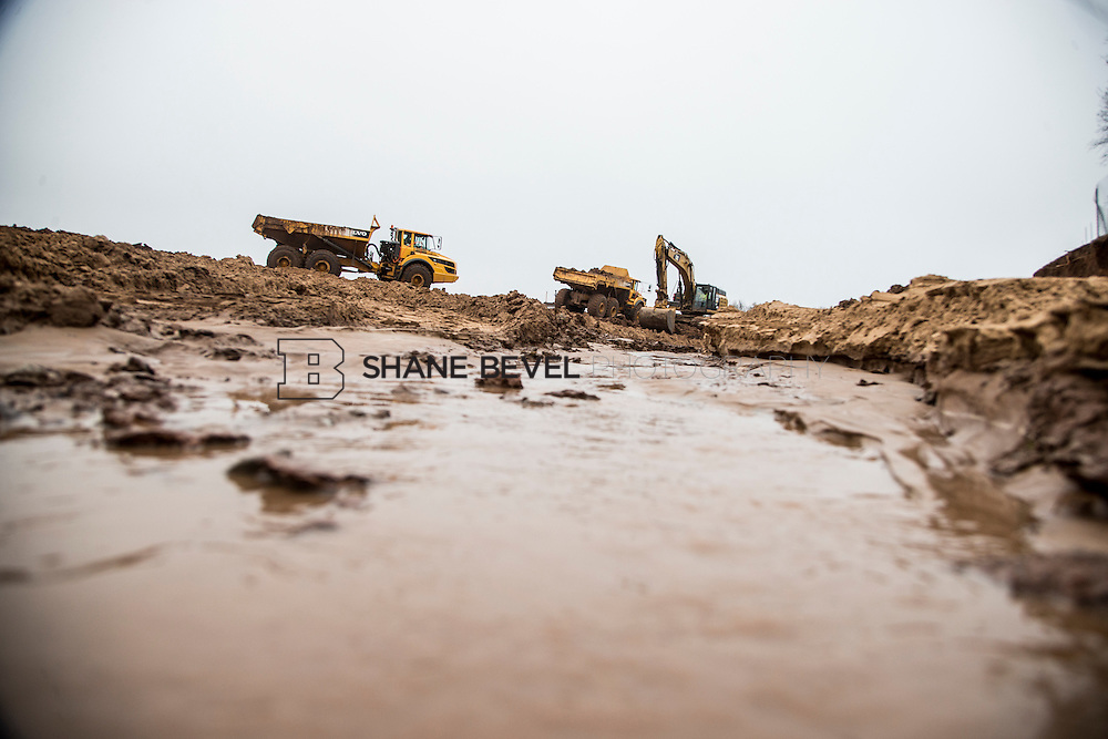 1/21/16 11:41:02 AM --  Construction work at The Gathering Place including setting and pouring the foundation of the lodge, drilling piers along riverside, and dredging the bottom of the pond.  <br /> <br /> Photo by Shane Bevel