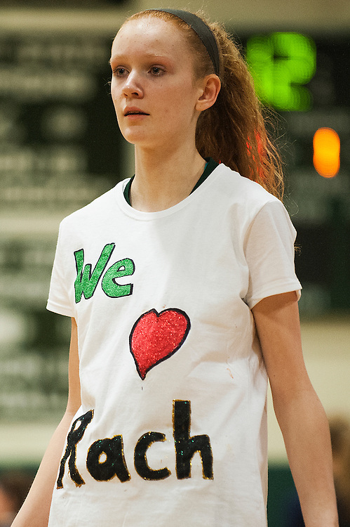 Rice's Lizzy Lyman (22) wears a shirt for senior Rachel Chicoine (not pictured) during the girls basketball game between the Burlington Sea Horses and the Rice Green knights at Rice Memorial high school on Thursday night February 18, 2016 in South Burlington. (BRIAN JENKINS/for the FREE PRESS)