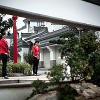 Guides stand at the ready in a newly-built gated residential community on the outskirts of Yangzhou, China, a suburb city of Shanghai and major producer of photovoltaic cells for solar power.