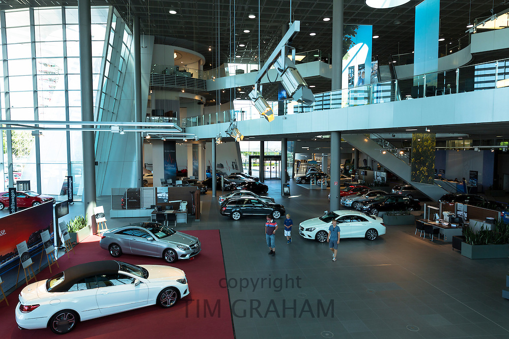 Prospective buyers in Mercedes-Benz gallery and showroom in Stuttgart, Bavaria, Germany