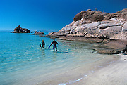 Couple snorkeling as part of a kayaking tour at Espiritu Santo Island in the Sea of Cortez near La Paz, Baja California Sur, Mexico.