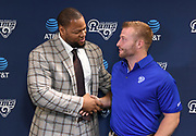 Apr 6, 2018; Thousand Oaks, CA, USA; Los Angeles Rams defensive tackle Ndamukong Suh (left) shakes hands with coach Sean McVay at a press conference at Cal Lutheran.