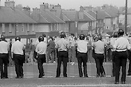 Riot police seal off Armthorpe, 1984 Miners Strike. 22 August 1984...&copy; Martin Jenkinson<br /> email martin@pressphotos.co.uk. Copyright Designs &amp; Patents Act 1988, moral rights asserted credit required. No part of this photo to be stored, reproduced, manipulated or transmitted to third parties by any means without prior written permission.