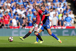 Wayne Rooney of Manchester United is challenged by Daniel Drinkwater of Leicester City - Rogan Thomson/JMP - 07/08/2016 - FOOTBALL - Wembley Stadium - London, England - Leicester City v Manchester United - The FA Community Shield.