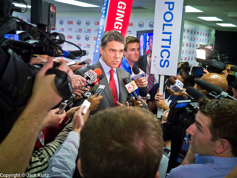 """22 FEBRUARY 2012 - MESA, AZ:  Texas Governor (and former Presidential candidate) RICK PERRY talks about Newt Gingrich's performance in the Arizona Republican Presidential Debate in the """"Spin Room"""" at Mesa Arts Center Wednesday night. Perry is endorsing Gingrich. Some of the candidates and their representatives visited the """"Spin Room"""" after the debate to discuss how well their candidates did in the two hour debate, the last one before the Arizona and Michigan primaries next week and """"Super Tuesday"""" on March 6.    PHOTO BY JACK KURTZ"""