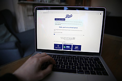 A person joins a long virtual queue to shop online at Boots website during the coronavirus outbreak. Picture date: Friday March 27, 2020. Photo credit should read: Isabel Infantes/EMPICS Entertainment