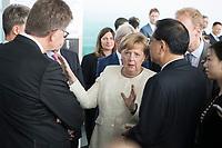 10 JUL 2018, BERLIN/GERMANY:<br /> Angela Merkel (M), CDU, Bundeskanzlerin, und Li Keqiang (R Ruecken), Ministerpraesident der VR China, waehrend einer Praesentation zum autonomen Fahren mit deutschen Autoherstellern, Flughafen Tempelhof<br /> IMAGE: 20180710-01-099