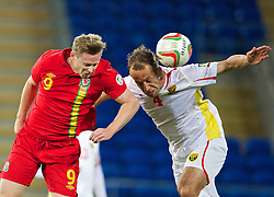 11.10.2013, City Stadion, Cardiff, WAL, FIFA WM Qualifikation, Wales vs Mazedonien, Gruppe A, im Bild Wales' Simon Church in action against Macedonia's Nikolce Noveski during the FIFA World Cup Qualifier Group A Match between Wales and Macedonia at the City Stadium, Cardiff, Wales on 2013/10/11. EXPA Pictures © 2013, PhotoCredit: EXPA/ Propagandaphoto/ David Rawcliffe<br /> <br /> ***** ATTENTION - OUT OF ENG, GBR, UK *****