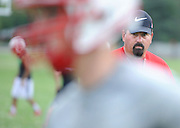 CANTON - AUGUST 10: Canton High School head football coach Tim Baechler watches his team during the first day of practice Monday, August 10, 2015 at Canton High School. (Photo by Bryan Mitchell)