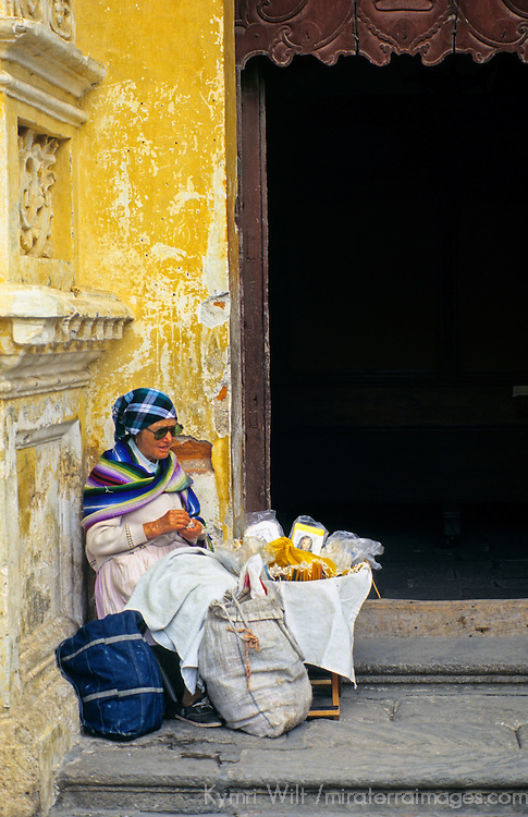 Central America, Guatemala, Antigua. A blind nun sits on the church steps selling pictures of Jesus to the seeing faithful in Antigua, Guatemala.