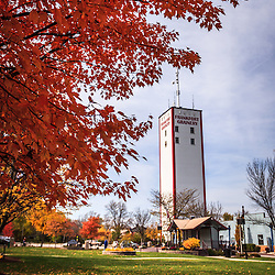 Photo of Frankfort Illinois in Autumn with the Frankfort Grainery in Breidert Green Park.  The Frankfort Grainery is a grain elevator and historic landmark in Frankfort Illinois, Frankfort is a Southwestern suburb of Chicago. The photo is vertical, high resolution and was taken in 2009.