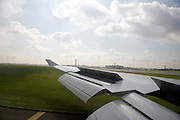 airplane landing at Charles de Gaulle airport Paris seen from inside the airplane