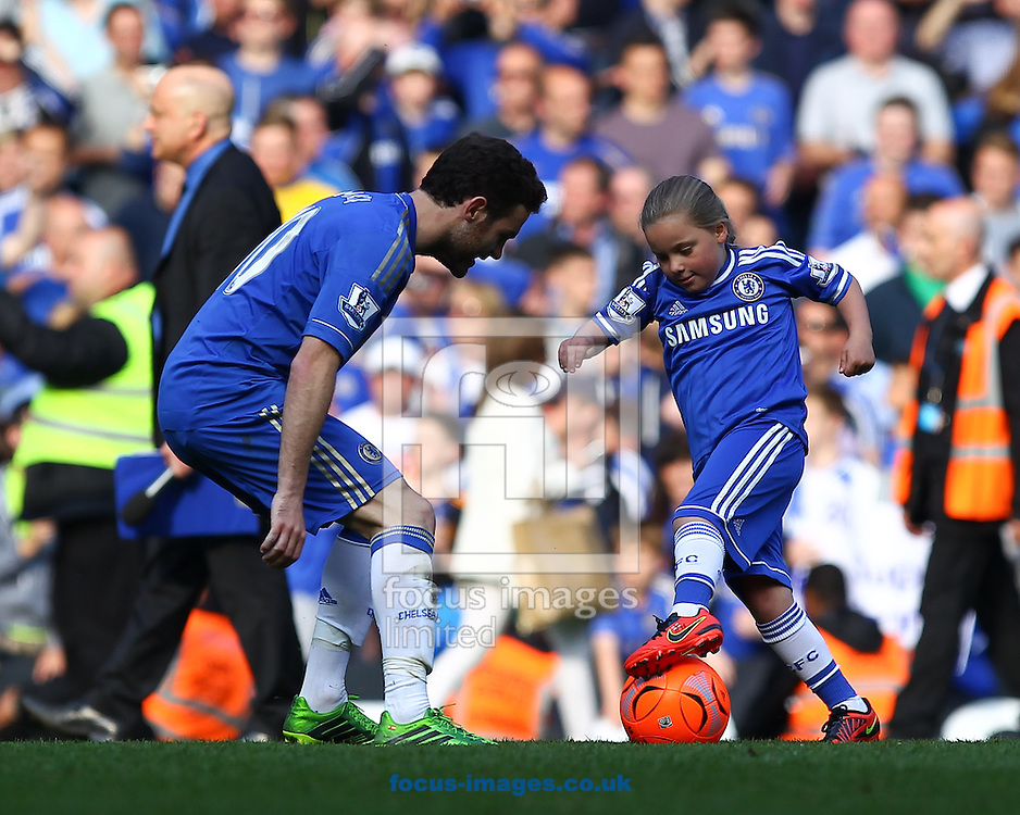 Picture by John Rainford/Focus Images Ltd +44 7506 538356.19/05/2013.Juan Mata of Chelsea plays football with John Terry's daughter Summer after the Barclays Premier League match at Stamford Bridge, London.